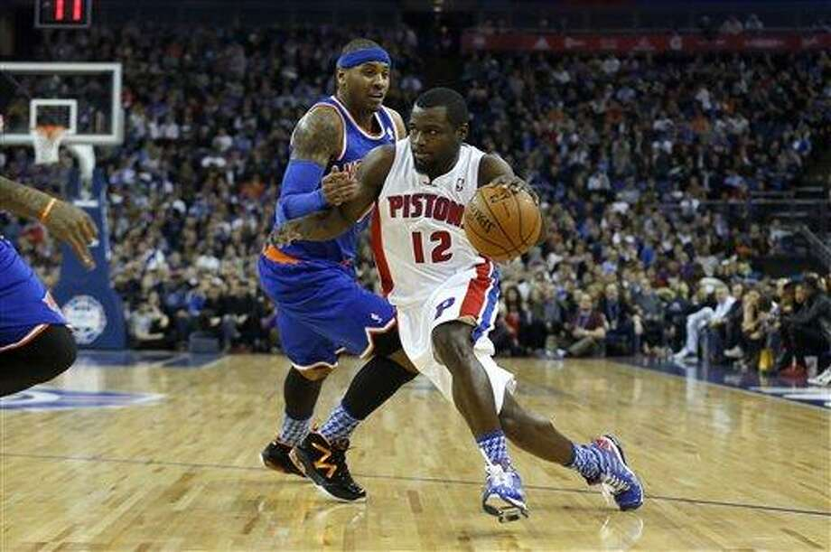 Detroit Pistons guard Will Bynum, right, tries to get past New York Knicks forward Carmelo Anthony during their NBA basketball game at the 02 arena in London, Thursday, Jan. 17, 2013.  (AP Photo/Matt Dunham) Photo: AP / AP
