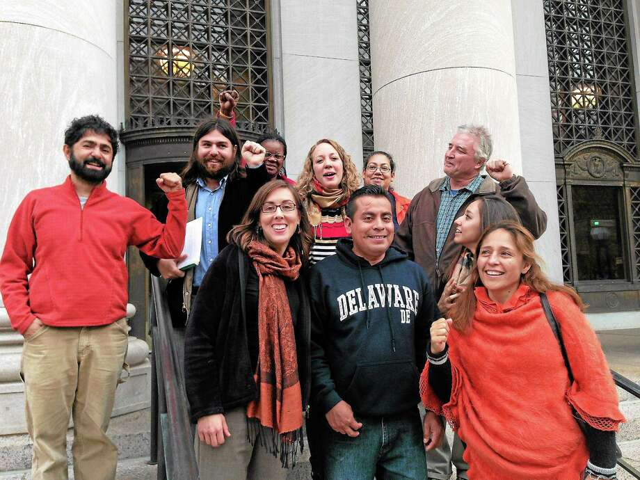 Four defendants and their supporters stand outside of the federal courthouse in New Haven after being sentenced to pay a fine. Photo by Rich Scinto Photo: Journal Register Co.