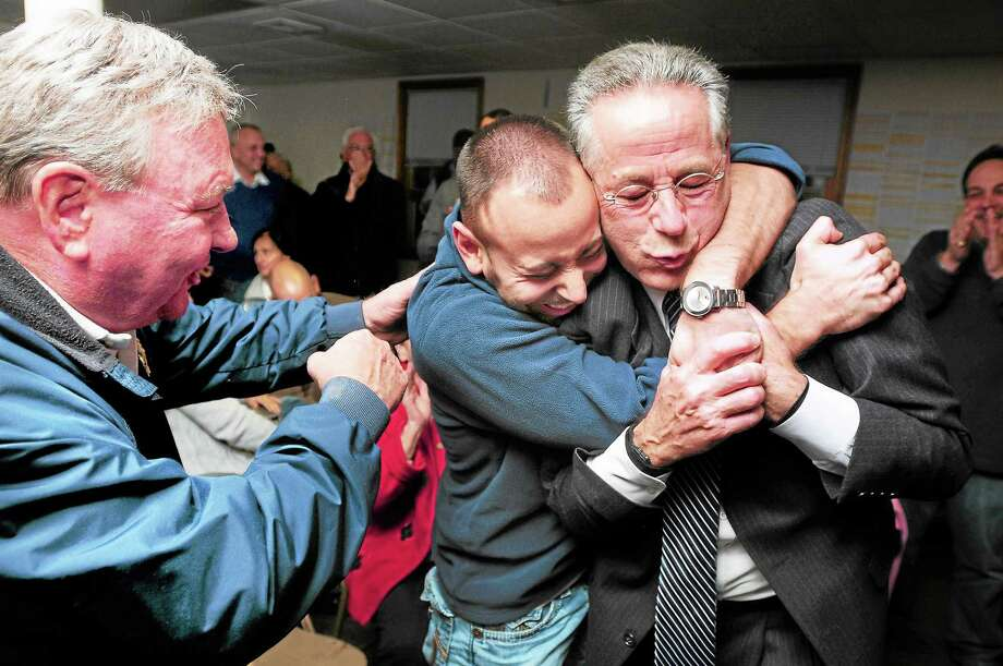 William Illingworth, left, commissioner on the board of the East Haven Police Department, Joseph Zullo, center, Maturo co-campaign manager, and East Haven Mayor Joseph Maturo Jr. celebrate as election results for the mayoral race are annnouced at Maturo headquarters in East Haven Tuesday night. Photo: Arnold Gold — New Haven Register