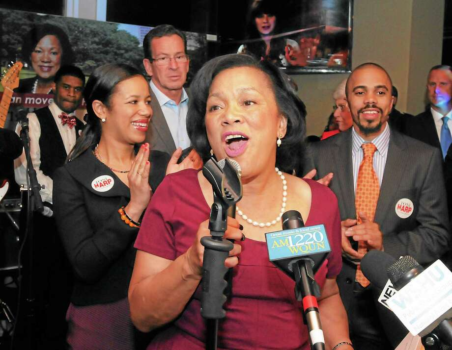 (Mara Lavitt — New Haven Register) November 5, 2013 New HavenKelly's Pub: Toni Harp addresses supporters after her election as mayor of New Haven. At left is her daughter Djana, at right is her son Matthew. Governor Dannel Malloy is second from left. Photo: Journal Register Co. / Mara Lavitt
