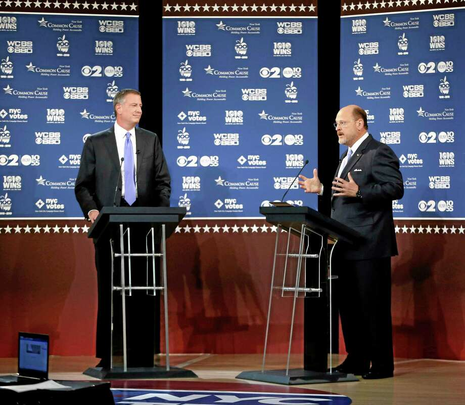 New York City Democratic mayoral candidate Bill de Blasio, left, listens as Republican candidate Joe Lhota makes a point during as they participate in the second of three debates prior to the Nov. 5 general election, Tuesday, Oct. 22, 2013, in New York. (AP Photo/ Kathy Willens, Pool) Photo: AP / Pool AP