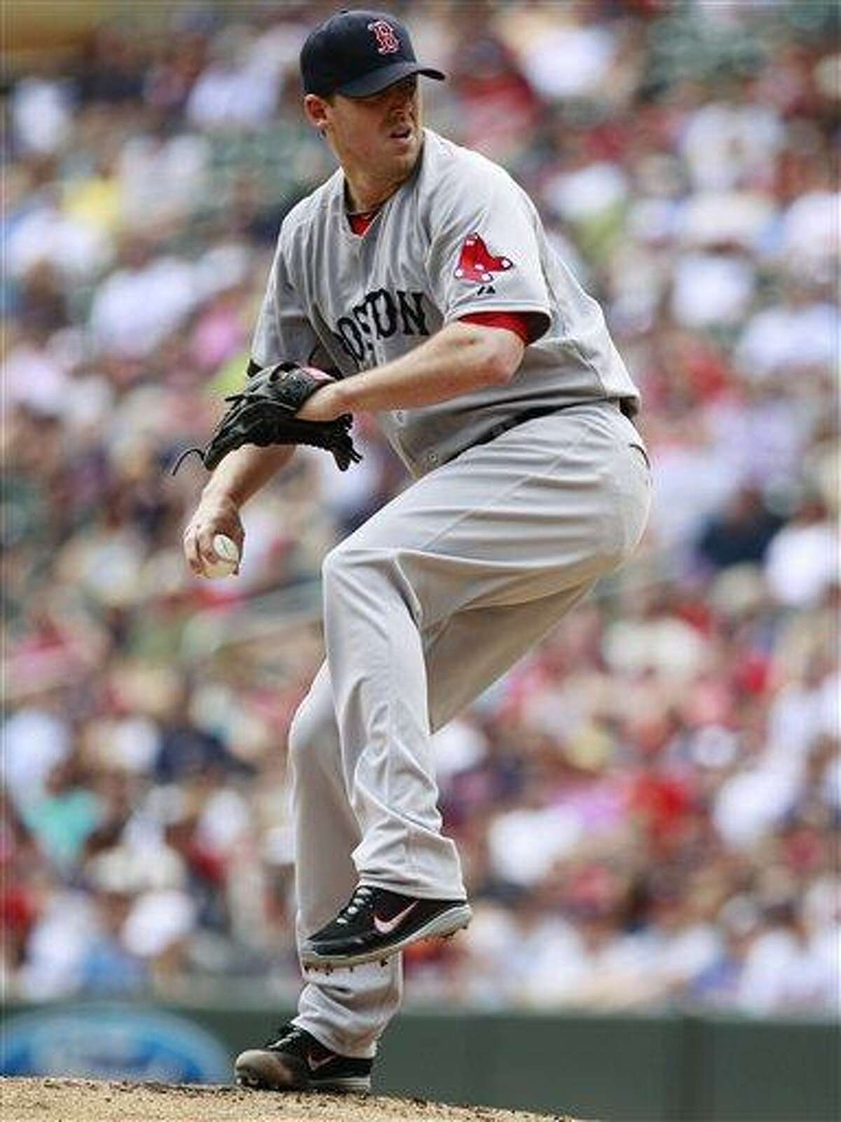 Boston Red Sox starting pitcher John Lackey (41) throws against the Minnesota Twins during the inning inning of a baseball game, Sunday, May 19, 2013, in Minneapolis. (AP Photo/Genevieve Ross)