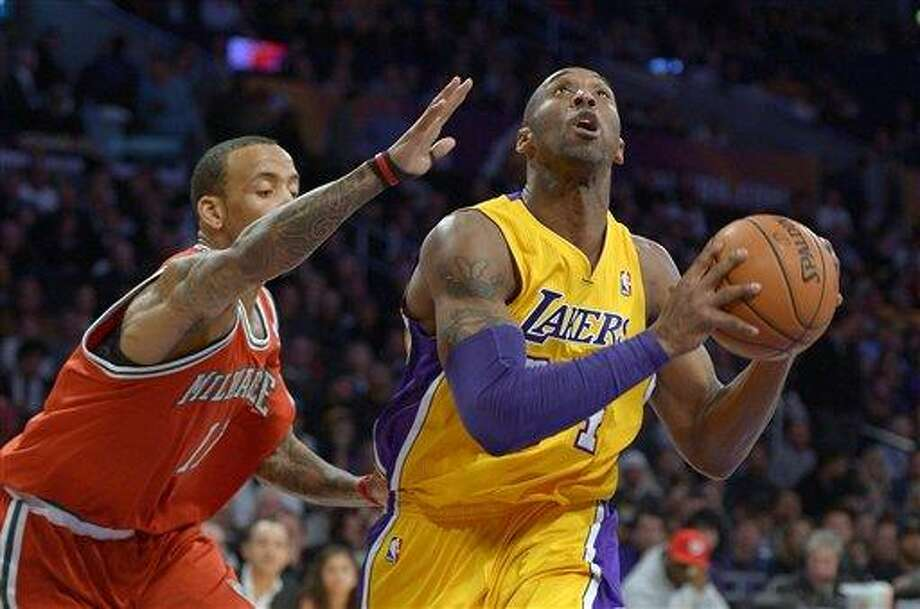 Los Angeles Lakers guard Kobe Bryant, right, goes up for a shot as Milwaukee Bucks guard Monta Ellis defends during the first half of an NBA basketball game, Tuesday, Jan. 15, 2013, in Los Angeles. (AP Photo/Mark J. Terrill) Photo: ASSOCIATED PRESS / Mark J. Terrill2013