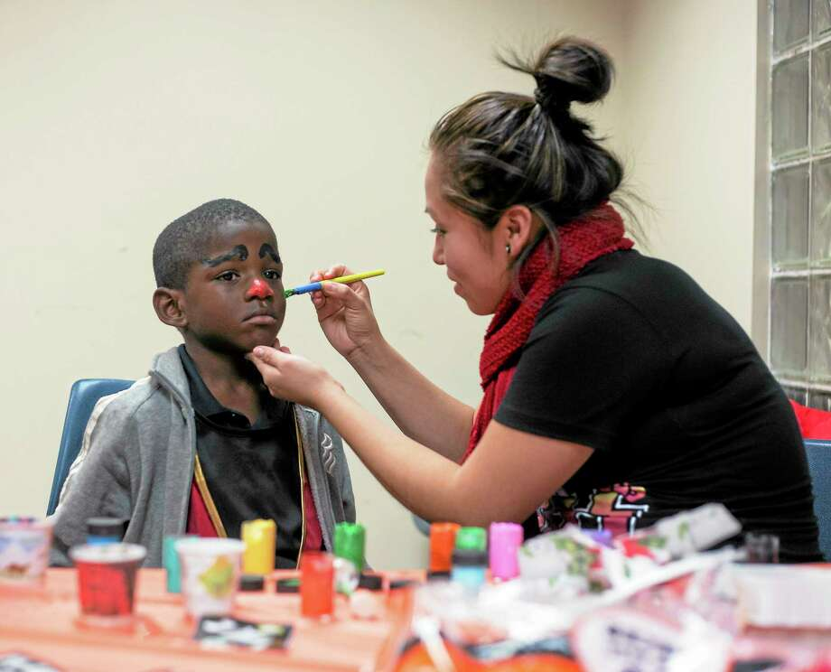 Tyquell Lucas, 5, gets his face painted at the Westville police substation Halloween event held Tuesday in New Haven. Photo: Rich Scinto — New Haven Register