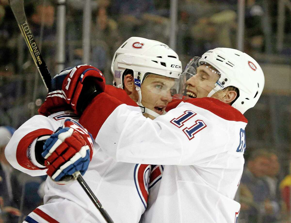 Montreal Canadiens right wing Brendan Gallagher (11) celebrates with Montreal Canadiens center Alex Galchenyuk (27) after Galchenyuk scored a goal in the third period of their game against the New York Rangers at Madison Square Garden. The Canadiens shut out the Rangers 2-0.