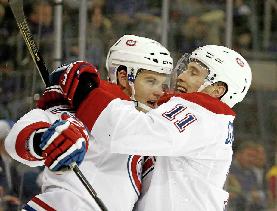 Montreal Canadiens right wing Brendan Gallagher (11) celebrates with Montreal Canadiens center Alex Galchenyuk (27) after Galchenyuk scored a goal in the third period of their game against the New York Rangers at Madison Square Garden.  The Canadiens shut out the Rangers 2-0. Photo: Kathy Willens  — The Associated Press   / AP