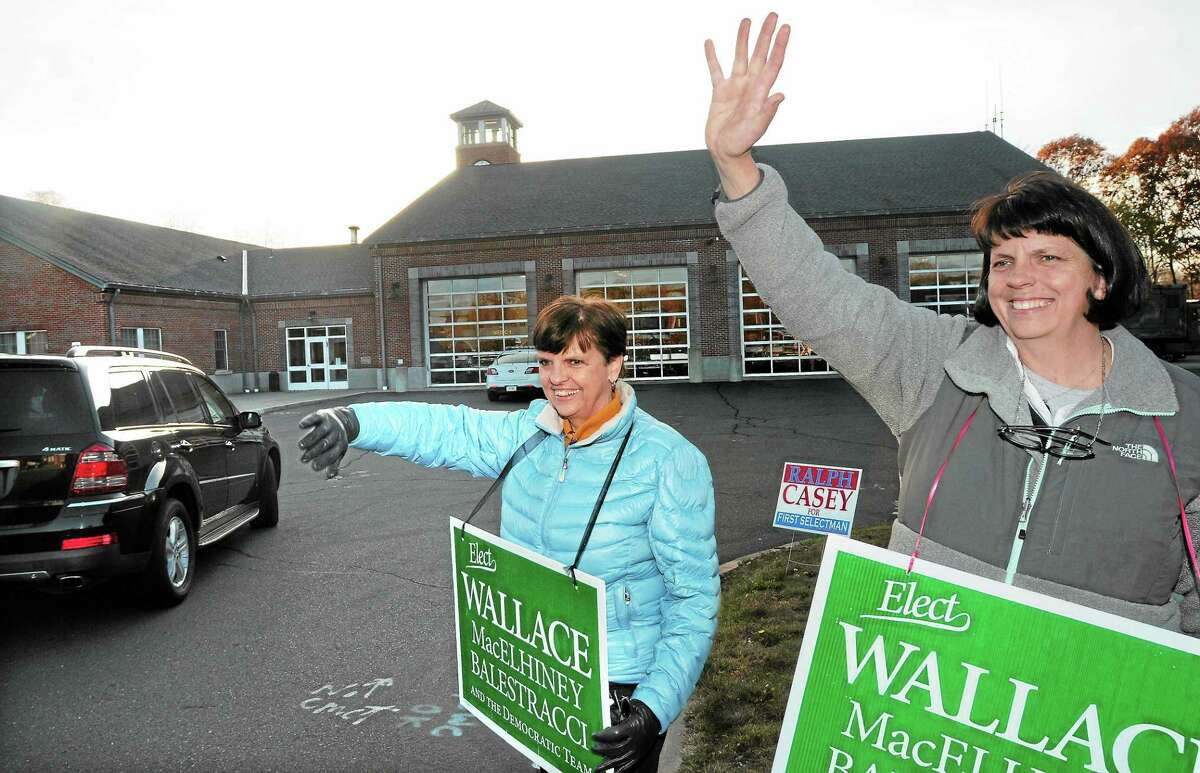 Maureen Collins of Branford, left, helped her sister and Guilford First Selectman candidate Veronica Wallace, right, greet voters outside the Fire Station polling location Tuesday.
