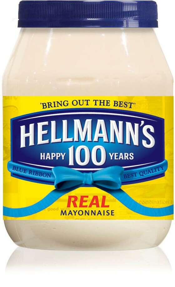 This undated image provided by Hellman's shows Hellmann's mayonnaise's special anniversary packaging. Hellman's turns 100 in 2013 and to celebrate the anniversary, owner Unilever Food is launching a marketing campaign including a Facebook page and YouTube videos featuring chef Mario Batali cooking up his favorite Hellman's recipes, a smartphone app and a June event featuring the world's largest picnic table. (AP Photo/Hellman's) Photo: AP / Hellman's