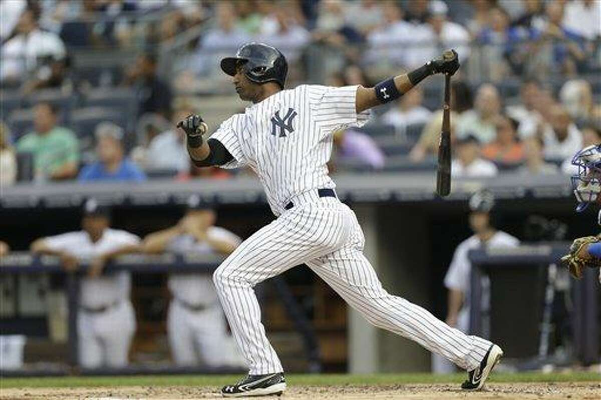 New York Yankees shortstop Eduardo Nunez bats in the first inning of the Yankees' loss to the Kansas City Royals Tuesday. (AP Photo/Kathy Willens).