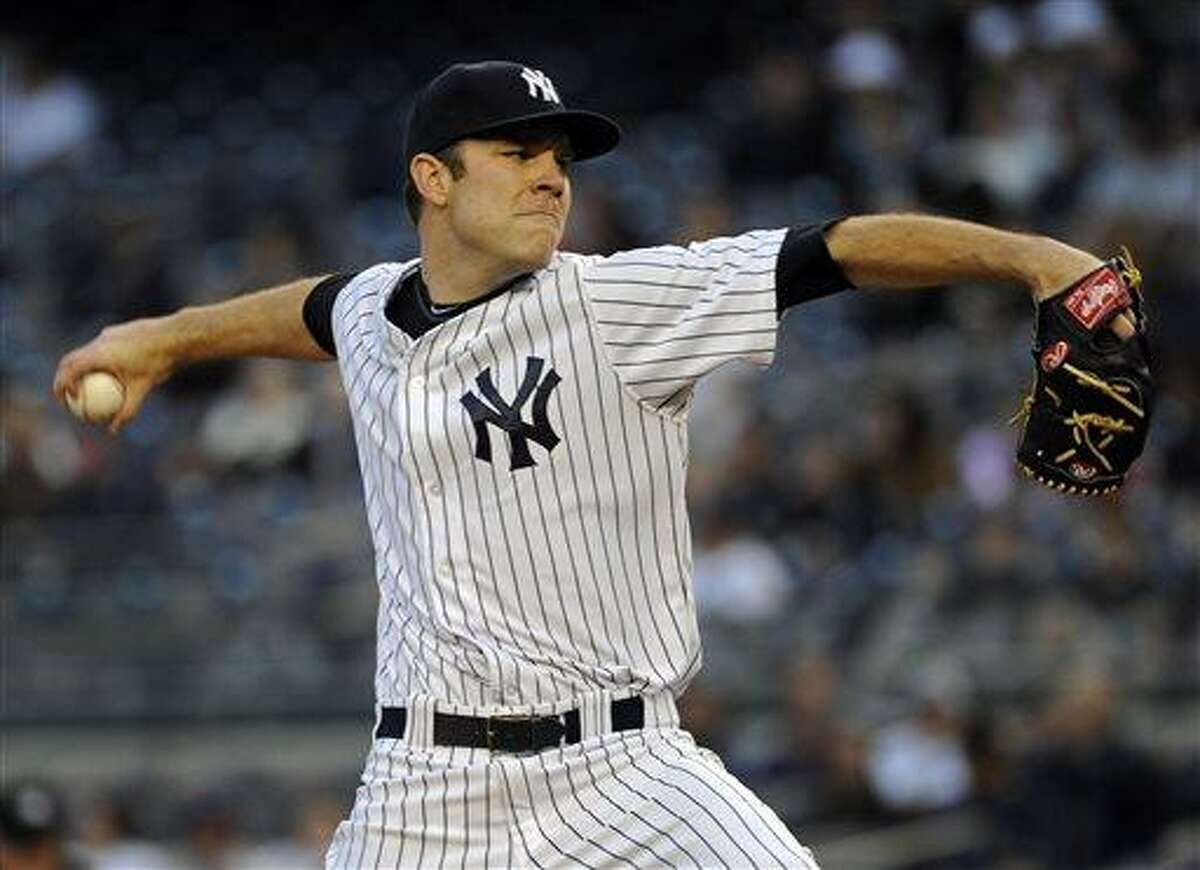 New York Yankees pitcher David Phelps delivers the ball to the Houston Astros during the first inning of a baseball game Wednesday, May 1, 2013, at Yankee Stadium in New York. (AP Photo/Bill Kostroun)