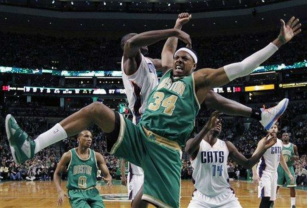 Boston Celtics' Paul Pierce (34) comes down after having his shot blocked by Charlotte Bobcats' Bismack Biyombo, behind, in the second half of an NBA basketball game in Boston, Saturday, March 16, 2013. The Celtics won 105-88. (AP Photo/Michael Dwyer)