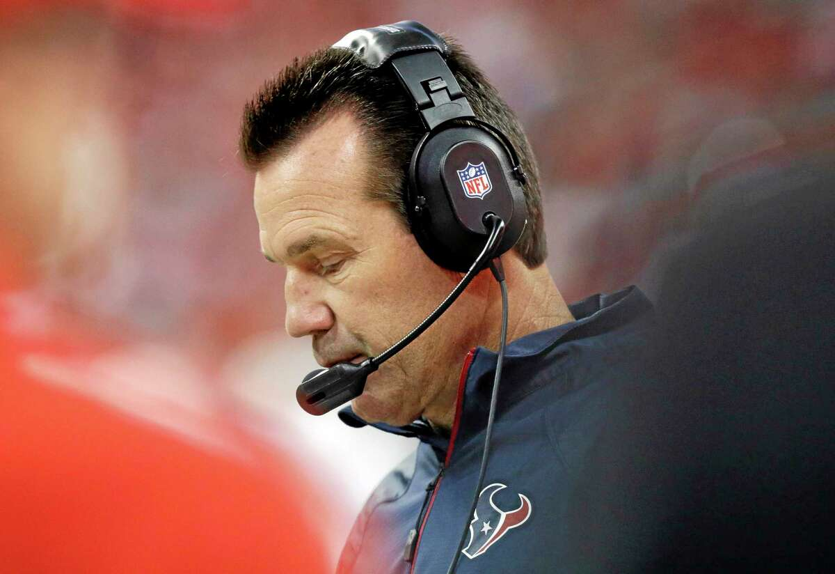Texans head coach Gary Kubiak watches from the sidelines during the first quarter of Sunday's game in Houston.