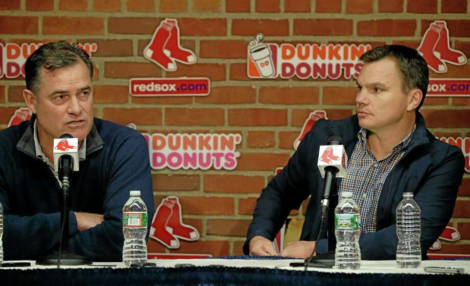 Boston Red Sox Executive Vice President/General Manager Ben Cherington, right, looks on as Sox Manager John Farrell responds to a reporter's question during a media availability at Fenway Park on Monday. Photo: Stephan Savoia — The Associated Press   / AP