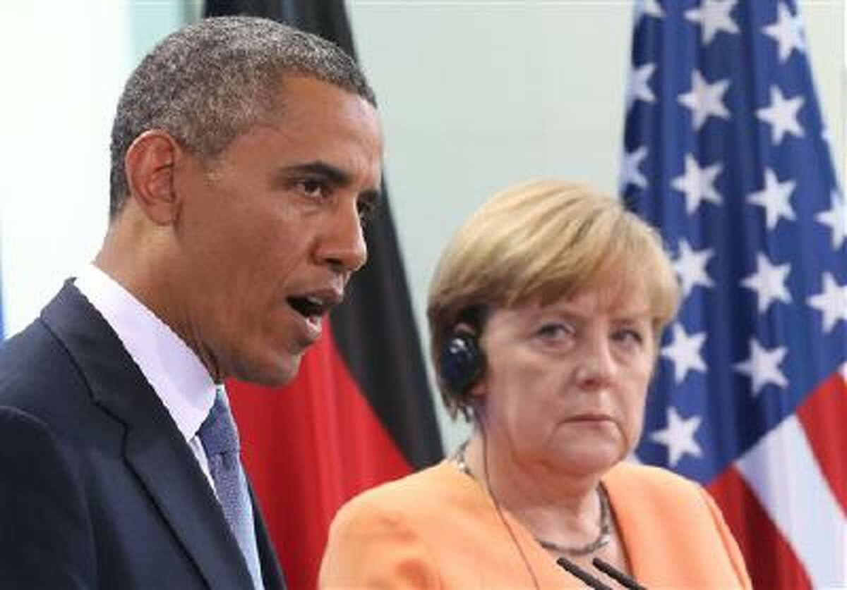 President Barack Obama speaks in June during a press conference with German Chancellor Angela Merkel at the Chancellery in Berlin.