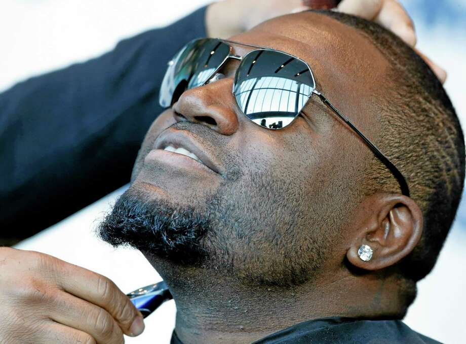 David Ortiz is shaved for One Fund Boston, the Boston Marathon charity for bombing victims, during a shave-off in Boston, Monday. Photo: Elise Amendola — The Associated Press   / AP
