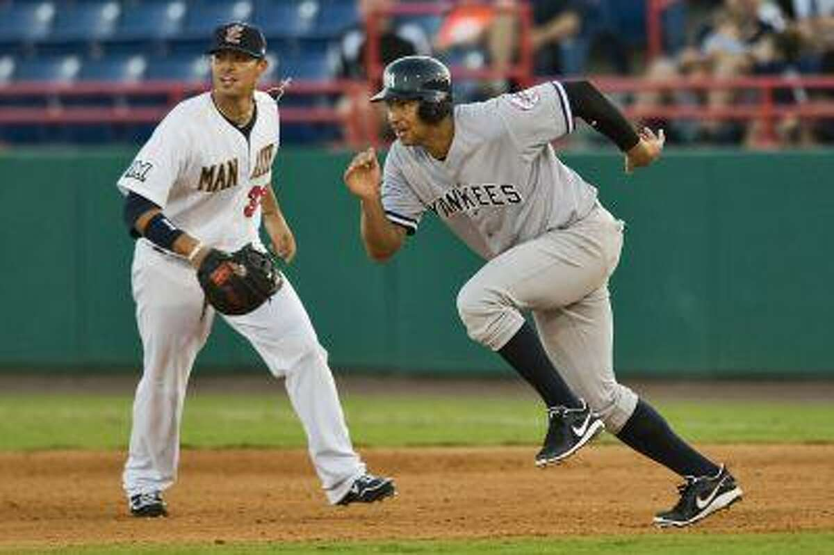 Brevard County Manatees first baseman Nick Ramirez (L looks on as Tampa Yankees' Alex Rodriguez (R) takes off from first on a base hit by Tampa's Peter O'Brien during the fifth inning of a Single A baseball game in Melbourne, Florida, July 6, 2013. REUTERS/Steve Nesius