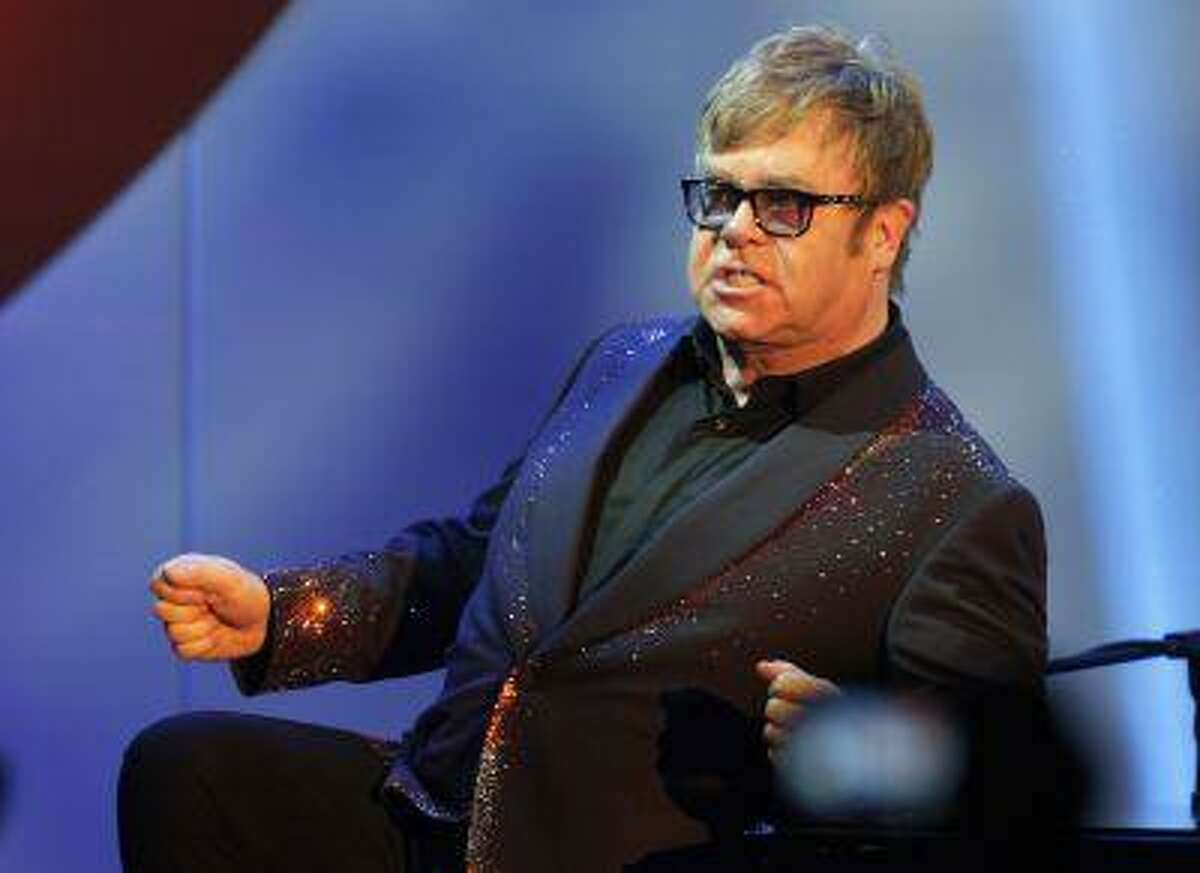 Musician Elton John acknowledges the audience during his performance at the 20th Annual Race to Erase MS benefit gala in Los Angeles May 3, 2013. The event raises money for funding research to find a cure for Multiple Sclerosis. REUTERS/Fred Prouser (UNITED STATES - Tags: ENTERTAINMENT)
