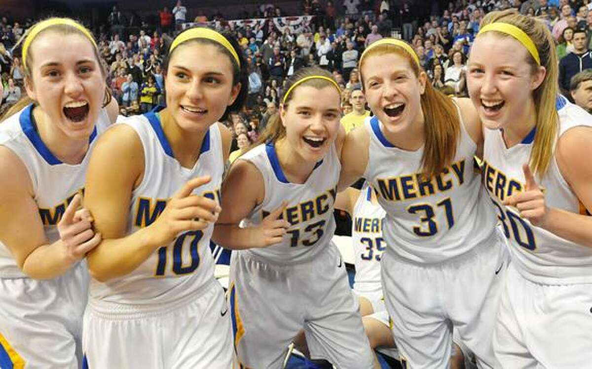 Catherine Avalone/The Middletown Press Mercy seniors Sheena Landy , Jordyn Nappi, team captain Maria Weselyj, Liz Falcigno and Cassie Santoro celebrate their 54-53 win over Lauralton Hall in the Class LL State Championship game at Mohegan Sun Saturday evening.