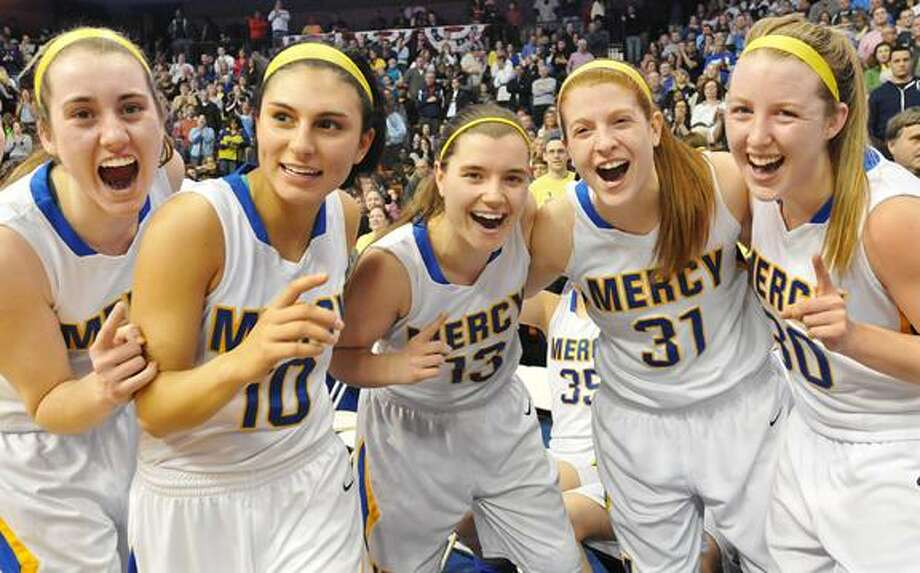 Catherine Avalone/The Middletown Press     Mercy seniors Sheena Landy , Jordyn Nappi, team captain Maria Weselyj, Liz Falcigno and Cassie Santoro celebrate their 54-53 win over Lauralton Hall in the Class LL State Championship game at Mohegan Sun Saturday evening. / TheMiddletownPress