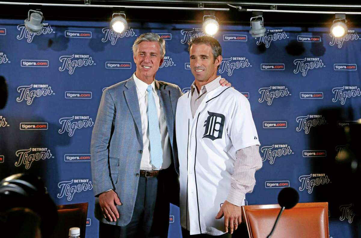 Detroit Tigers general manager David Dombrowski, left, introduces Brad Ausmus as the new Detroit Tigers manager during a news conference in Detroit Sunday.