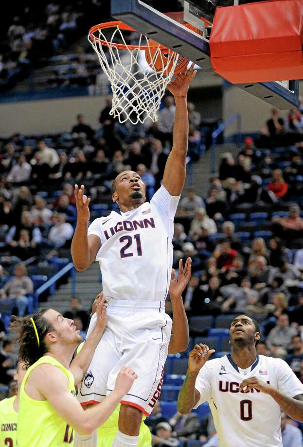 UConn's Omar Calhoun scores during the first half Monday's exhibition game against Concordia. Photo: Fred Beckham — The Associated Press   / FR153656 AP