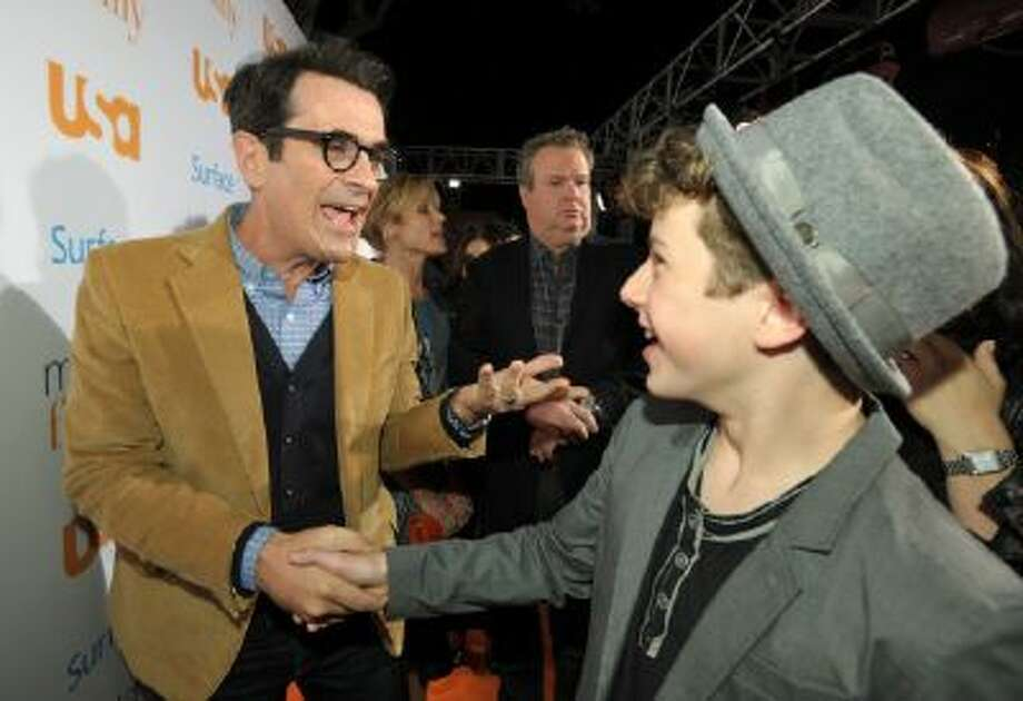 """Cast members Ty Burrell, left, and Nolan Gould shake hands at USA Network's """"Modern Family"""" Fan Appreciation Day at the Westwood Village Theatre on Monday, Oct. 28, 2013 in Los Angeles."""