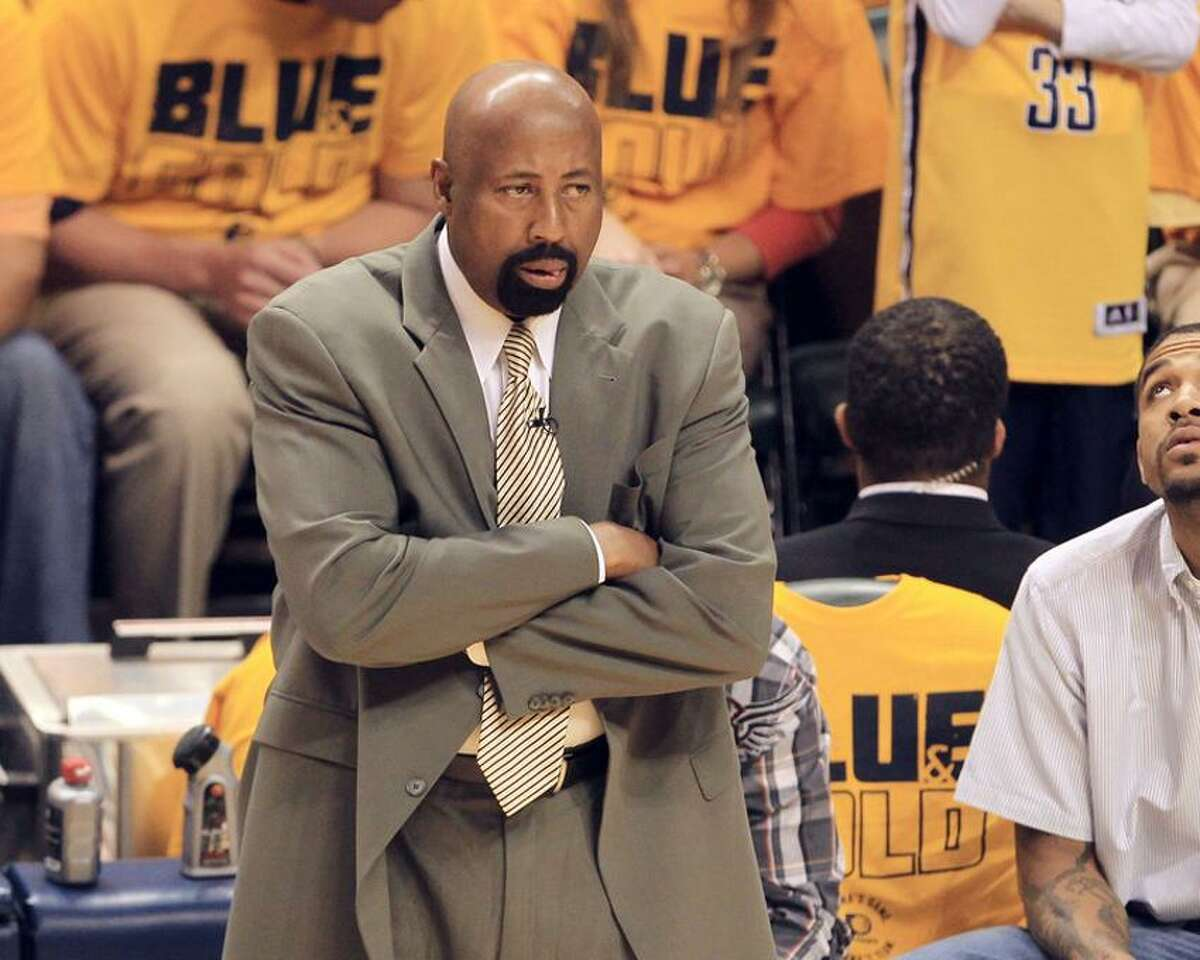 May 18, 2013; Indianapolis, IN, USA; New York Knicks head coach Mike Woodson looks on from the bench against the Indiana Pacers in game six of the second round of the 2013 NBA Playoffs at Bankers Life Fieldhouse. Mandatory Credit: Pat Lovell-USA TODAY Sports