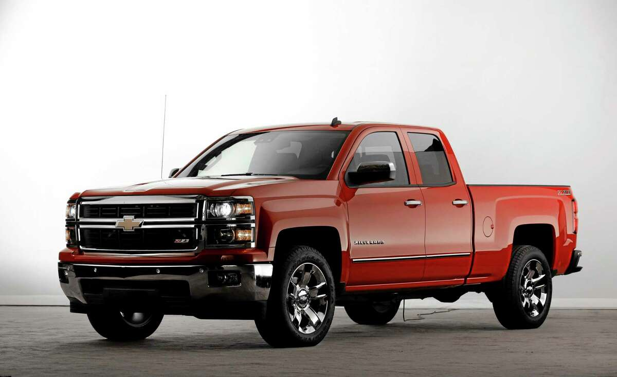 In this Dec. 13, 2012, file photo, the 2014 Chevrolet Silverado Z71 debuts in Pontiac, Mich. General Motors is adding almost $2,100 to the sticker price of the base 2014 Chevrolet Silverado. Despite a general rise in prices, the U.S government is expected to lose about $9.7 billion in bailout money on GM. (AP Photo/Paul Sancya, File)