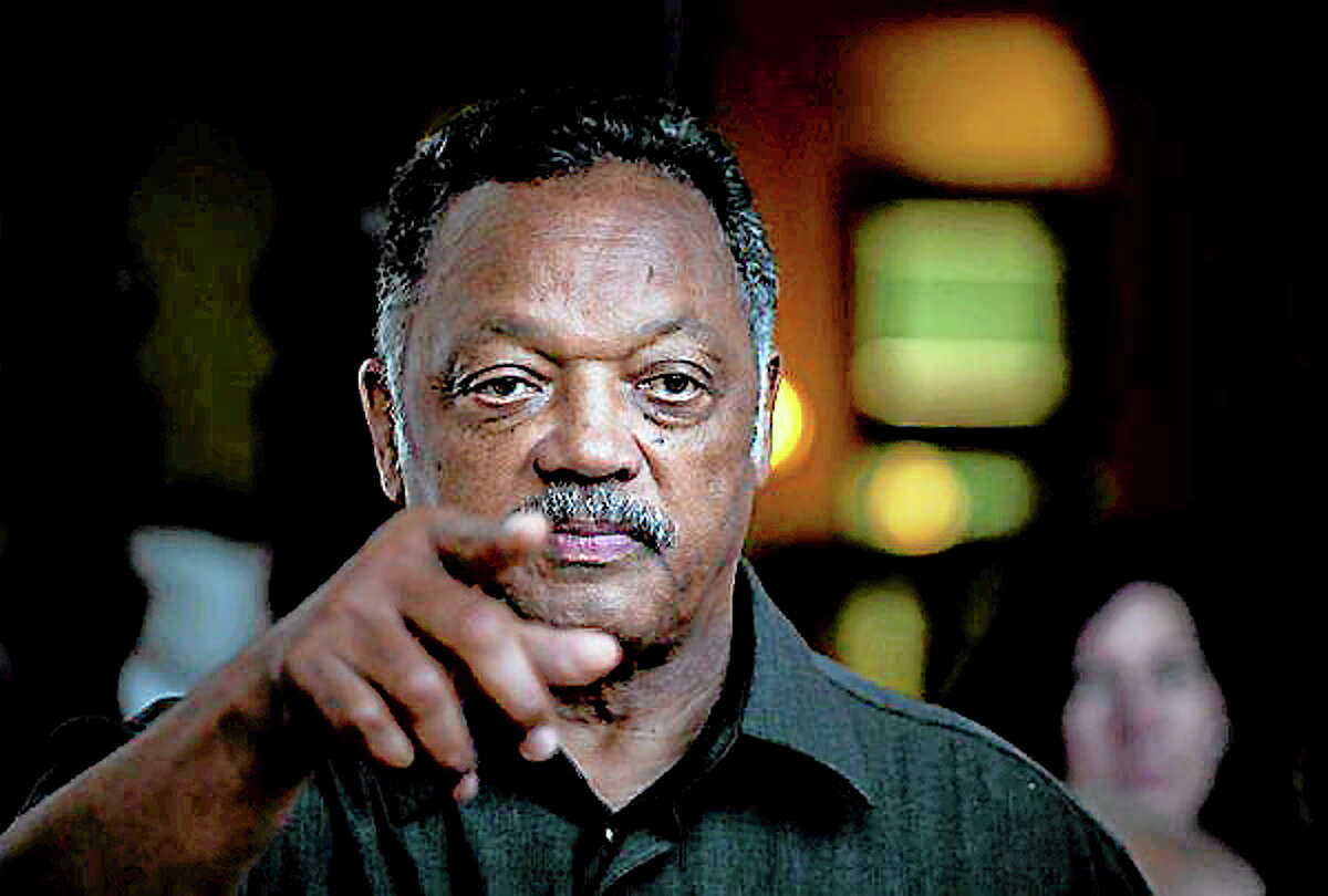 Rev. Jesse Jackson points to a reporter as he takes questions during an impromptu news conference at the Hotel Nacional in Havana, Cuba, Sept. 28.
