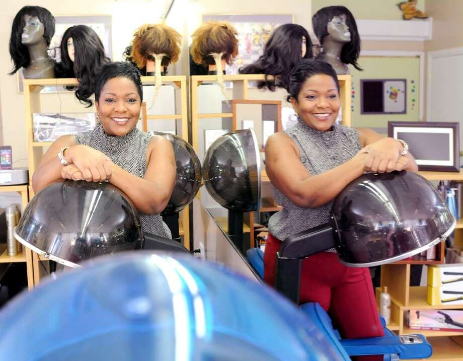 Karaine Holness, owner of Hair's Kay Academy of Cosmetology on Fitch Street in New Haven,  Connecticut March 13, 2013, a new not-for-profit cosmetology school. Holness wants to creat jobs and opportunity in her community.  Photo by Peter Hvizdak / New Haven Register Photo: New Haven Register / ©Peter Hvizdak /  New Haven Register