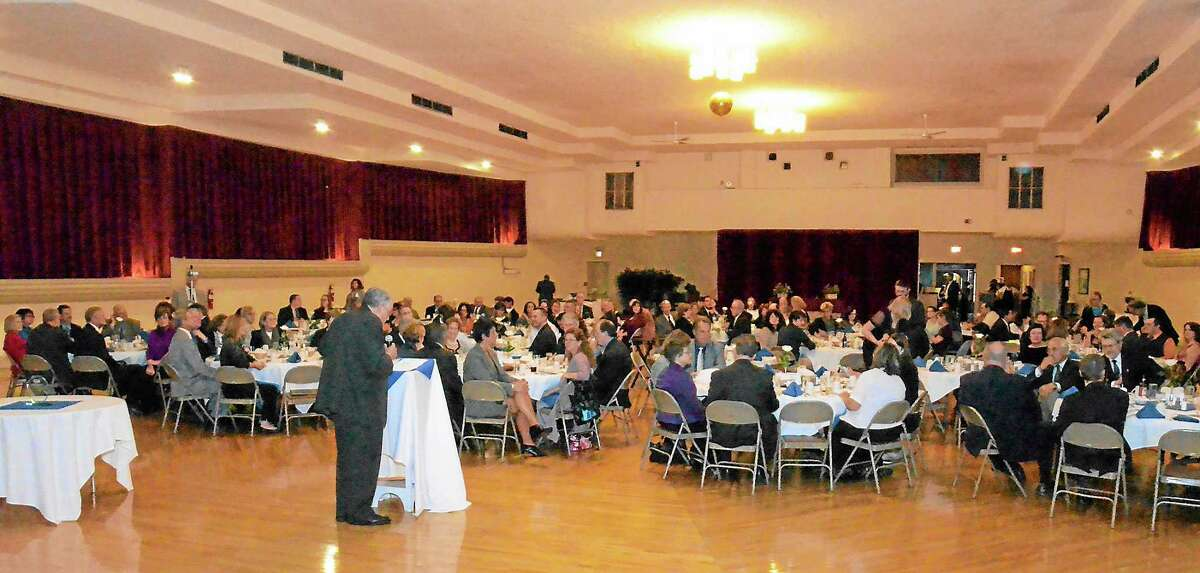 Kurt Wanfried-The Oneida Daily Dispatch @OneidaEditor on TwitterEmcee Mike Healy talks to the assembled crowd of about 180 at Friday evening chamber dinner.