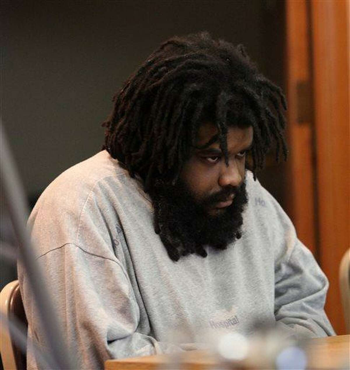 Tyree Smith sits during the first day of his trial before a three judge panel in Bridgeport, Conn., July 1, 2013. Smith is accused of killing and then eating parts of a homeless man in Connecticut. (AP Photo/The Connecticut Post, B.K. Angeletti) MANDATORY CREDIT