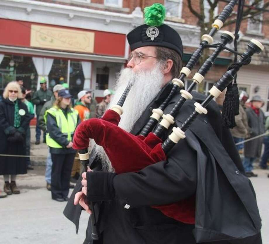 John Haeger @OneidaPhoto on Twitter/Oneida Daily Dispatch Solo bagpiper Gill Mason makes his way along the parade route during  the 12th annual St. Patrick's Day Parade on Saturday, March 16, 2013 in Camden.