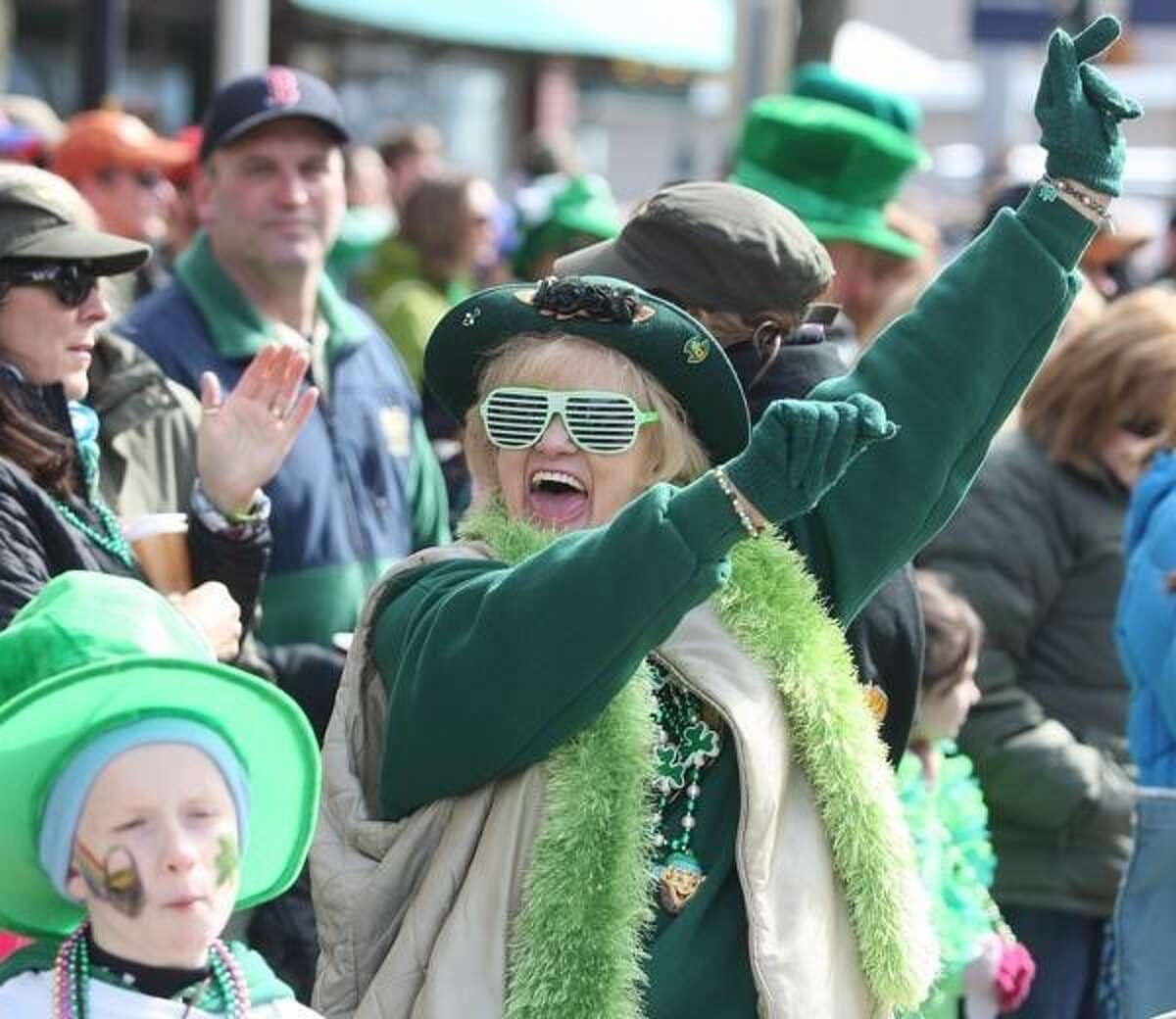 John Haeger @OneidaPhoto on Twitter/Oneida Daily Dispatch Densie Fenton cheers as the 12th annual St. Patrick's Day Parade passes by on Saturday, March 16, 2013 in Camden.