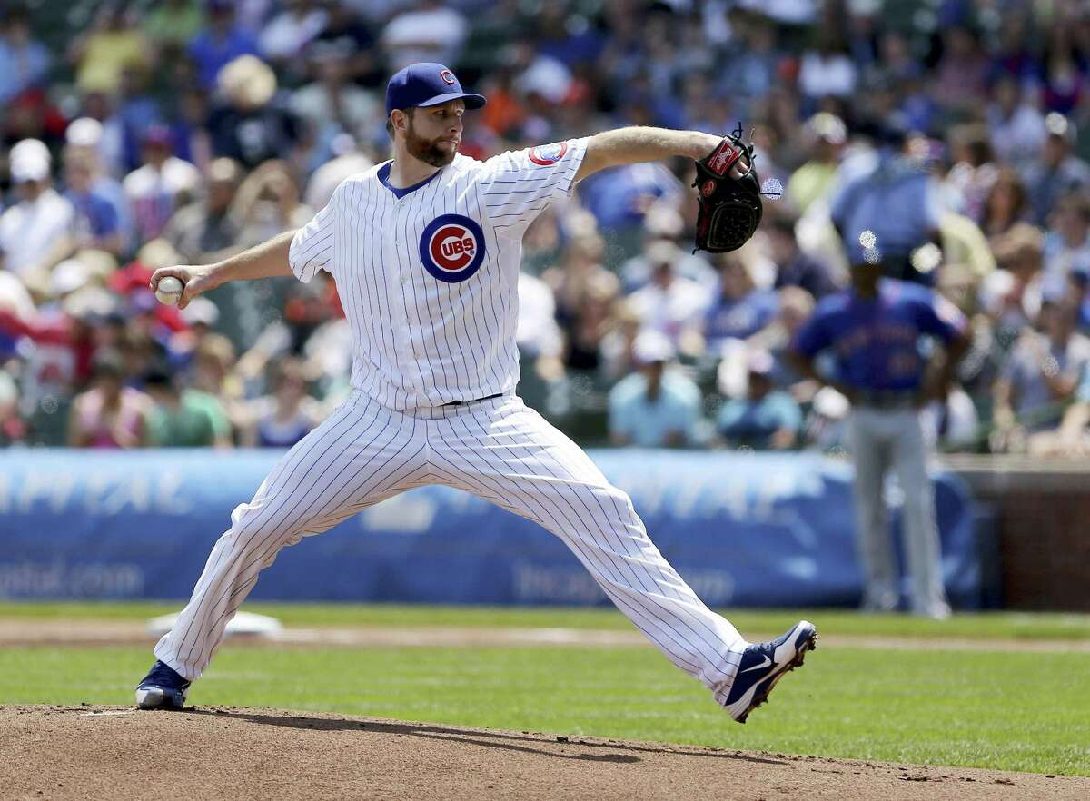 Chicago Cubs starter Scott Feldman pitches to the New York Mets in the first inning of a baseball game in Chicago on Saturday, May 18, 2013. (AP Photo/Charles Cherney)