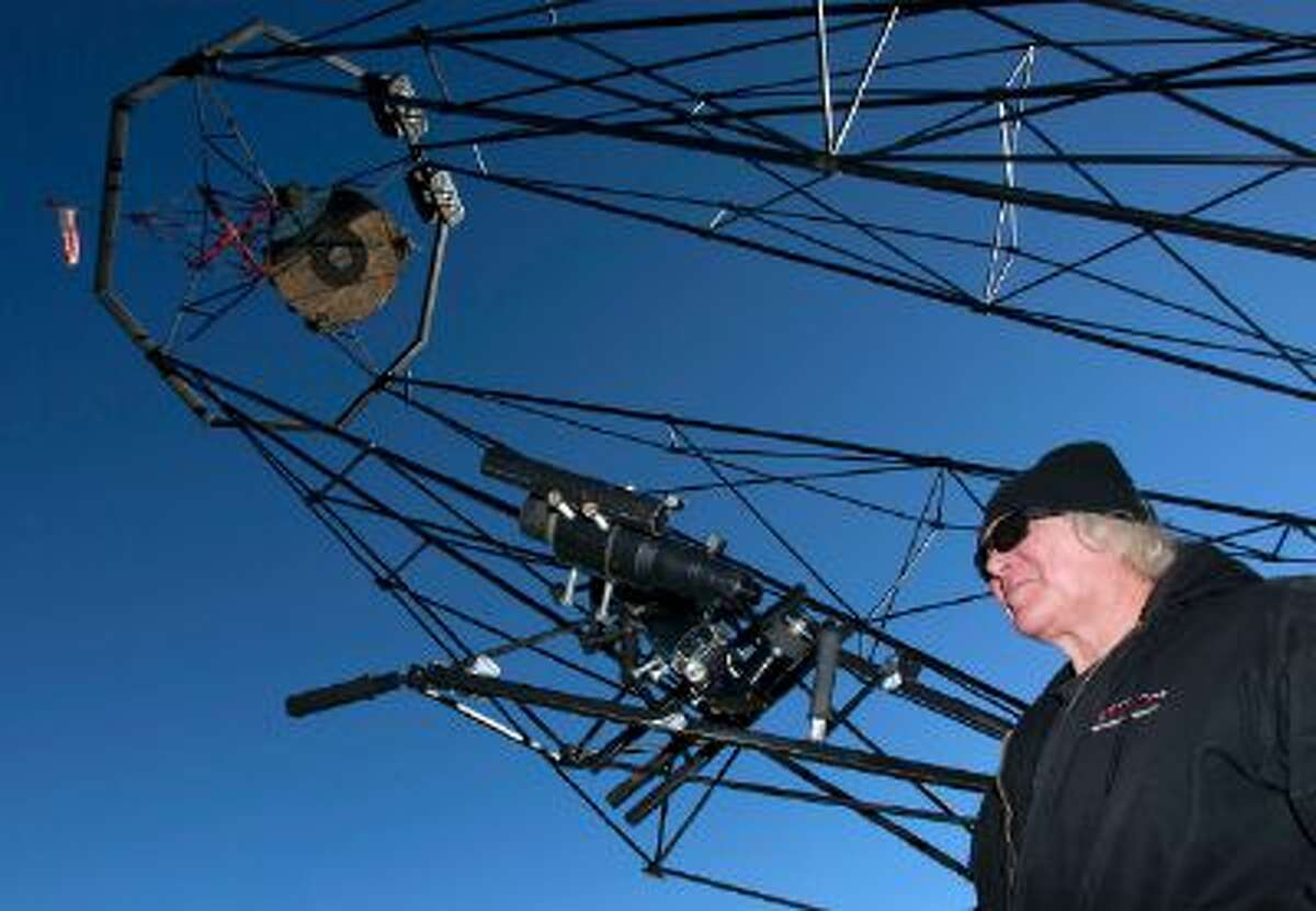 Mike Clements with his homemade 70-inch telescope in Herriman, Utah, Sunday, October 27, 2013. The 70-inch mirror and 35 foot length make it one of the biggest telescopes created by an amateur astronomer.