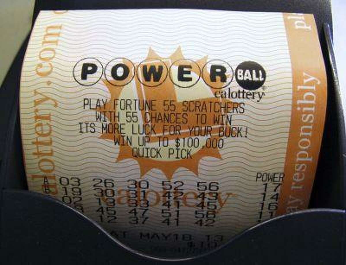 A Powerball lottery ticket is printed out of a lottery machine after purchase at a convenience store in Encinitas, California, May 17, 2013.
