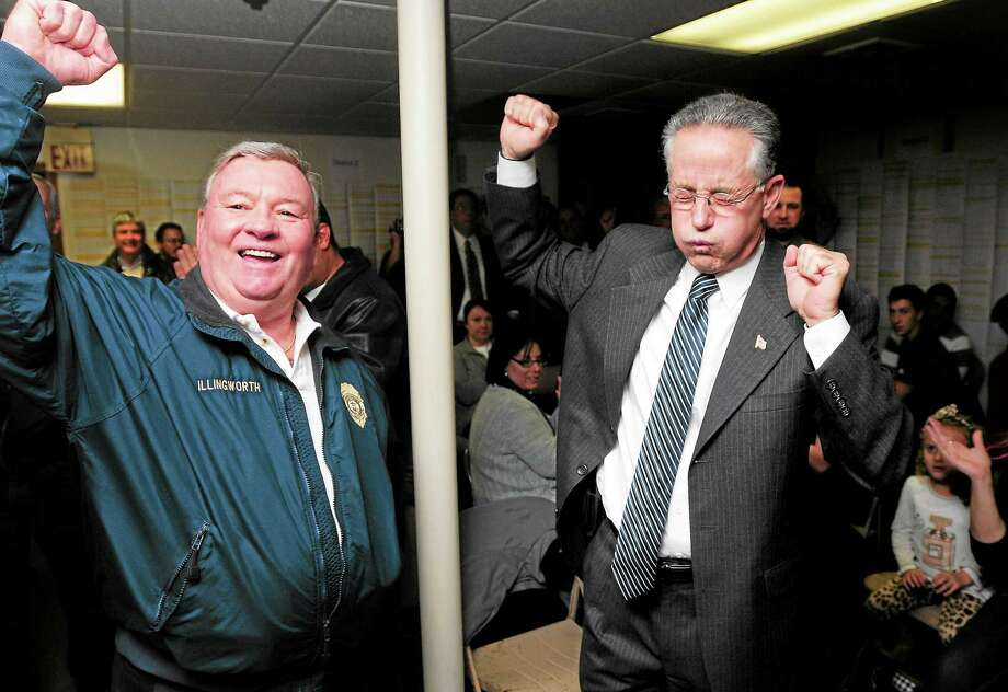 William Illingworth, left, commissioner on the Board of the East Haven Police Department, and East Haven Mayor Joseph Maturo Jr., celebrate as election results for the mayor's race are annnouced at Maturo headquarters in East Haven Tuesday night. Photo: Arnold Gold — Register