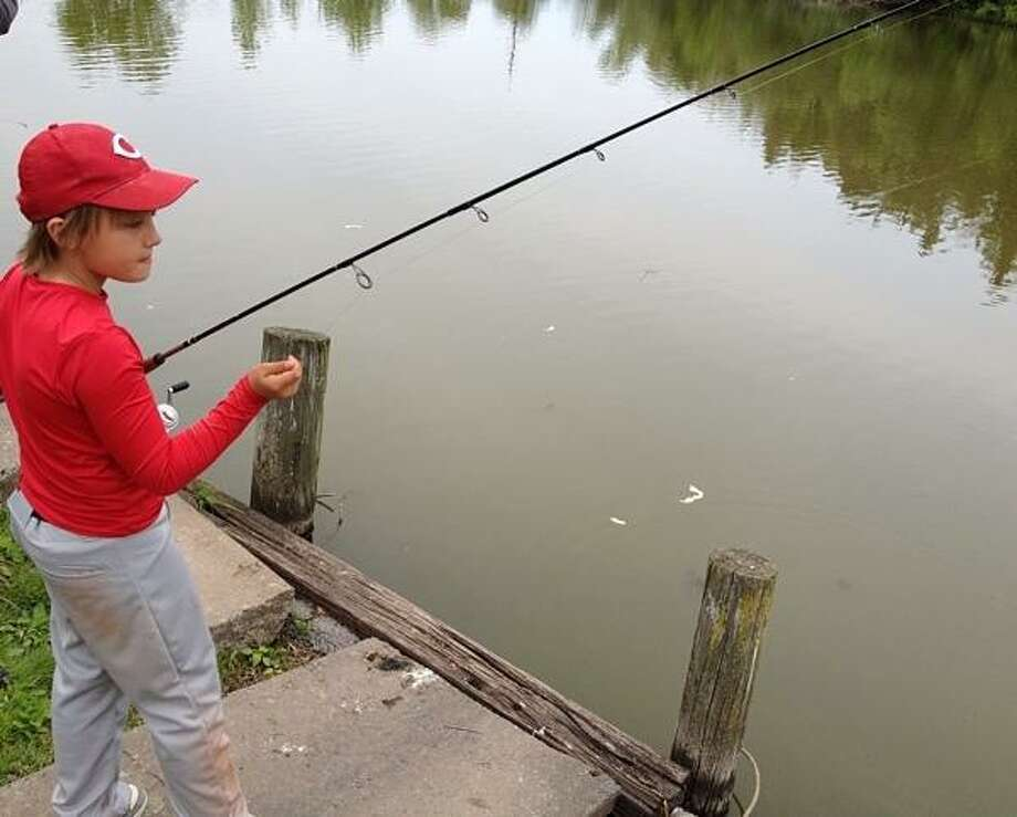 PHOTO BY JOHN HAEGER @ ONEIDAPHOTO ON TWITTER/ONEIDA DAILY DISPATCH Shane Plack ,10, of Canastota tests his skills during the annual fishing derby in Sherrill on Saturday, May 18, 2013.