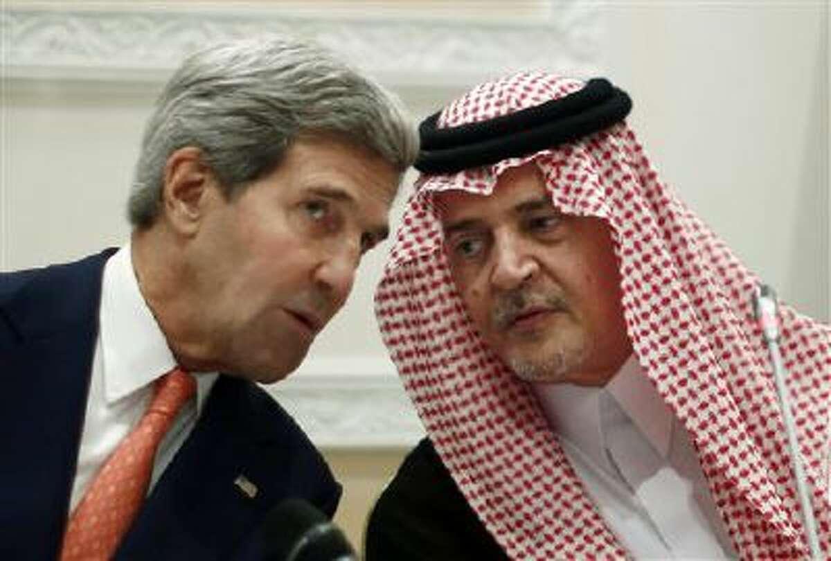 U.S. Secretary of State John Kerry, left, speaks Monday with Saudi Arabia's Foreign Minister Prince Saud al-Faisal in Riyadh.