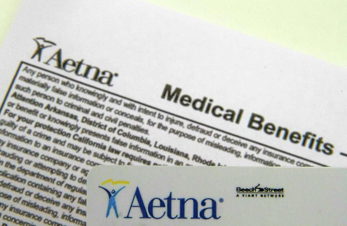 An Aetna benefits card in seen Surfside, Fla.