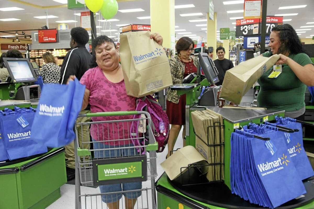 Customers shop at a Walmart in Los Angeles in September.