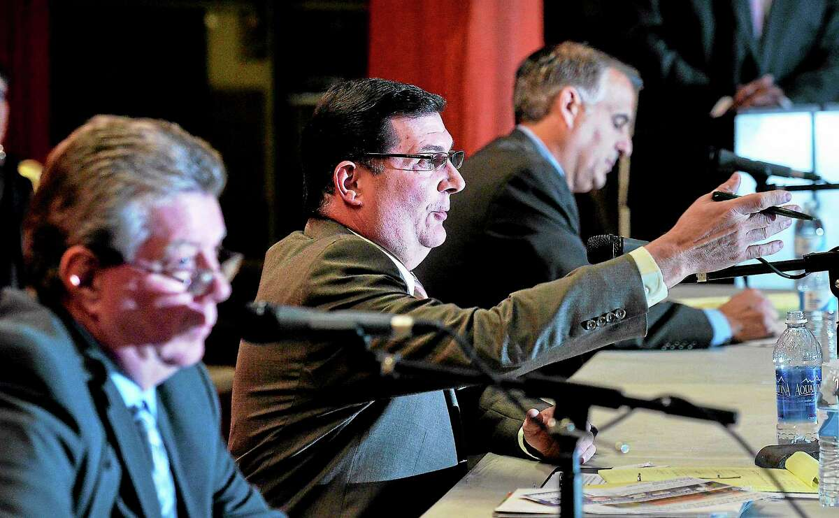 (Peter Casolino — New Haven Register) Democrat candidate Edward O'brien makes a point during the West Haven Mayoral debate at Carrigan Intermediate School on Tuesday night. On the left is Republican candidate Bart Chadderton, and on the right is Mayor (and write-in candidate) John M. Picard. pcasolino@NewHavenRegister
