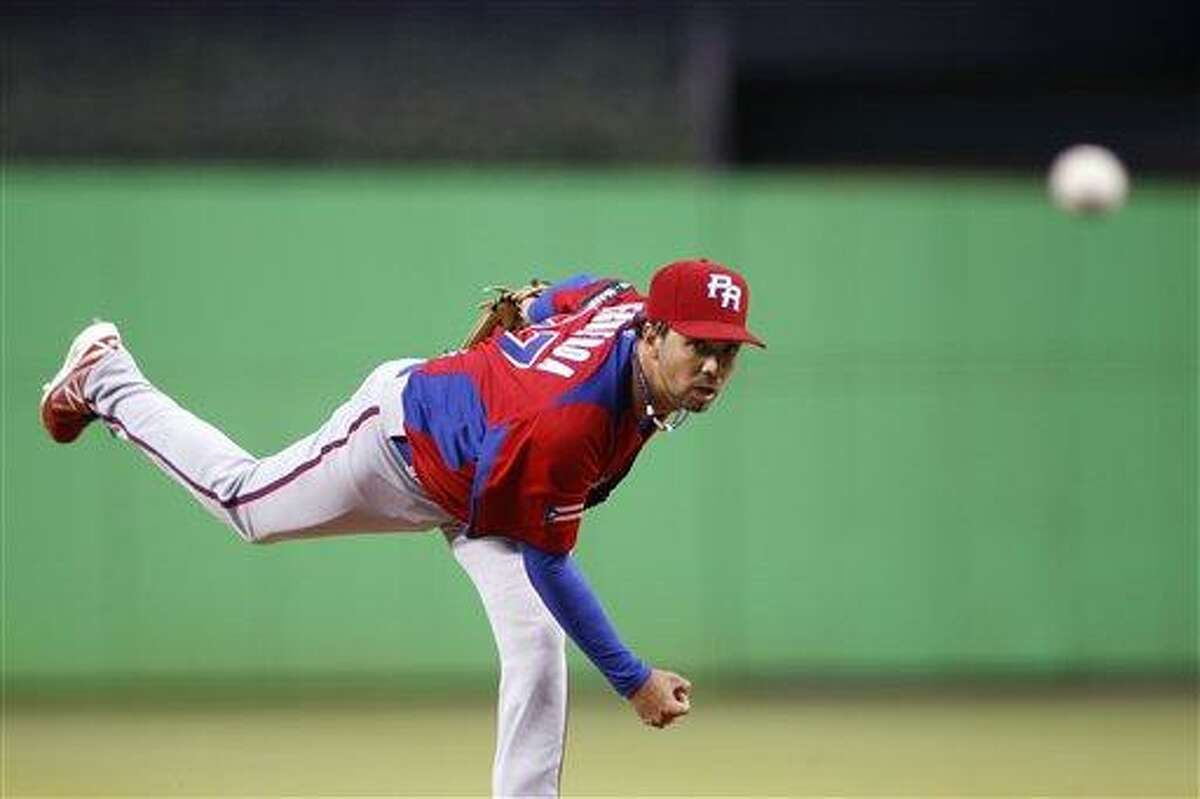 Puerto Rico's Nelson Figueroa delivers a pitch during the first inning of the second round elimination game at the World Baseball Classic against the United States, Friday, March 15, 2013 in Miami. (AP Photo/Andrew Innerarity, Pool)