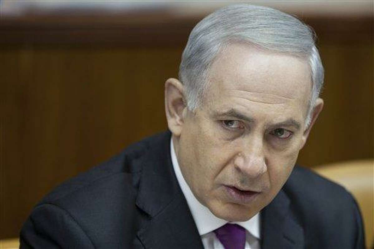 Israeli Prime Minister Benjamin Netanyahu attends the weekly cabinet meeting in Jerusalem on Sunday, July 7, 2013. (AP Photo/Oded Balilty)