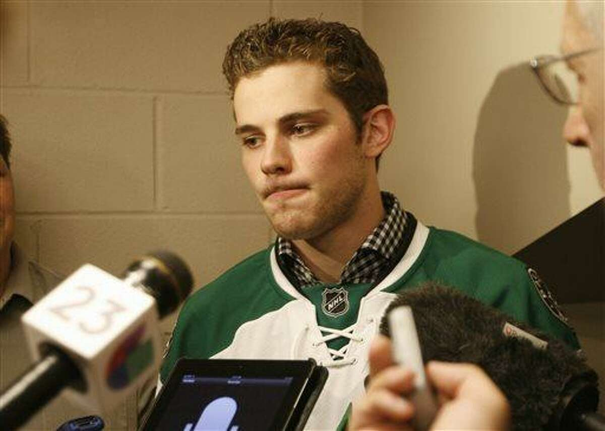 Tyler Seguin speaks to reporters at a press conference where he was introduced as an NHL hockey Dallas Stars player in Dallas, Tuesday, July 8, 2013. (AP Photo/Mike Fuentes)