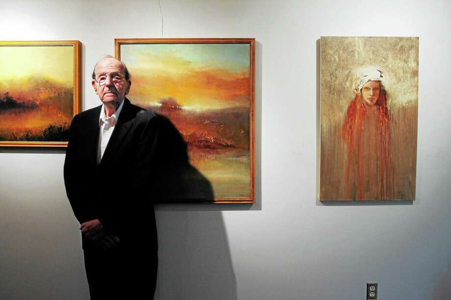 "Artist Maurice Sapiro is surrounded by his oil paintings in his North Haven home, from left, ""Marsh Mist,"" ""Across the River"" and ""White Cloche."" Photo: Arnold Gold — New Haven Register"