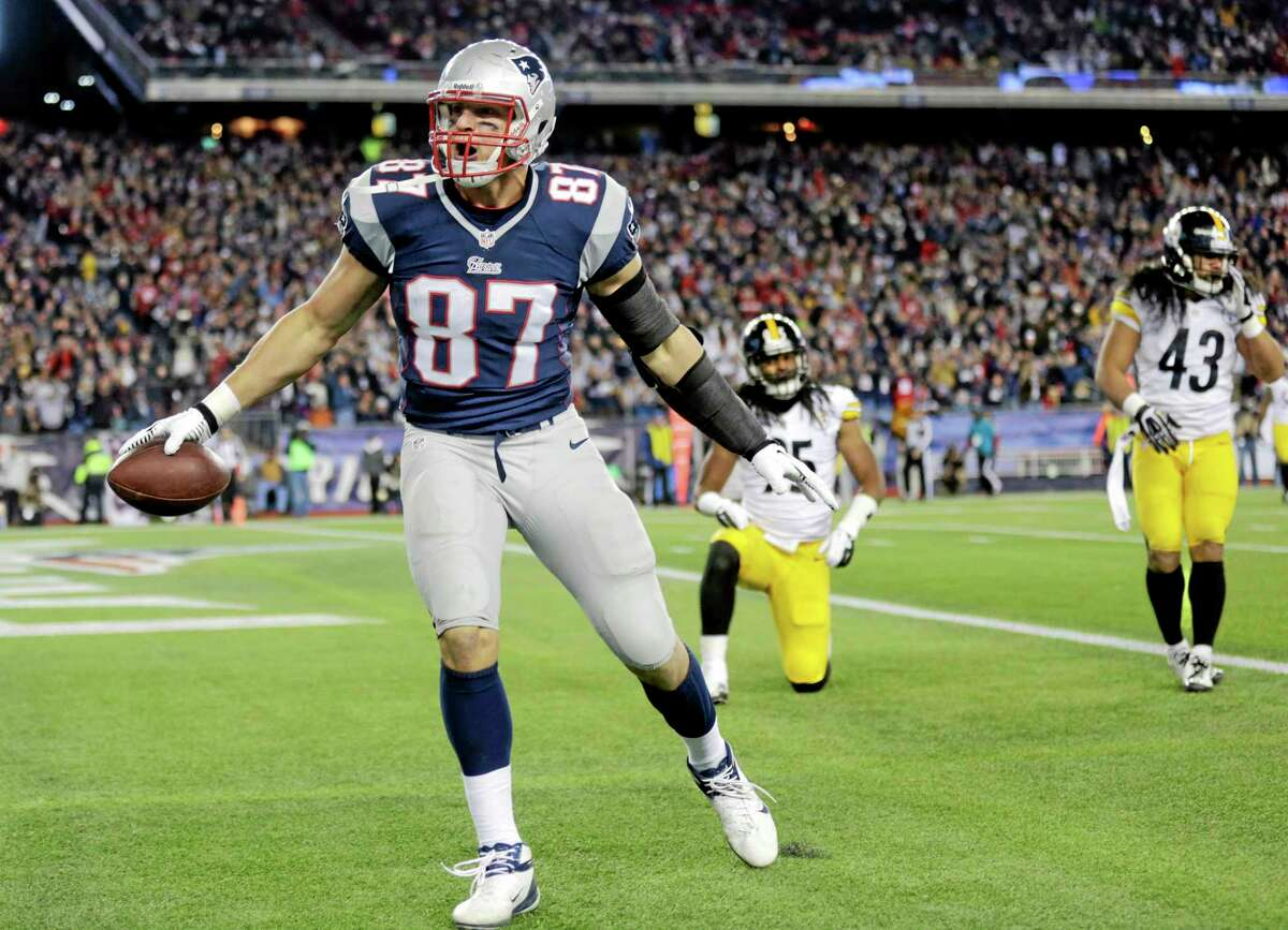 Patriots tight end Rob Gronkowski celebrates his touchdown catch in front of Steelers safeties Ryan Clark, back left, and Troy Polamalu (43) during the second quarter Sunday.