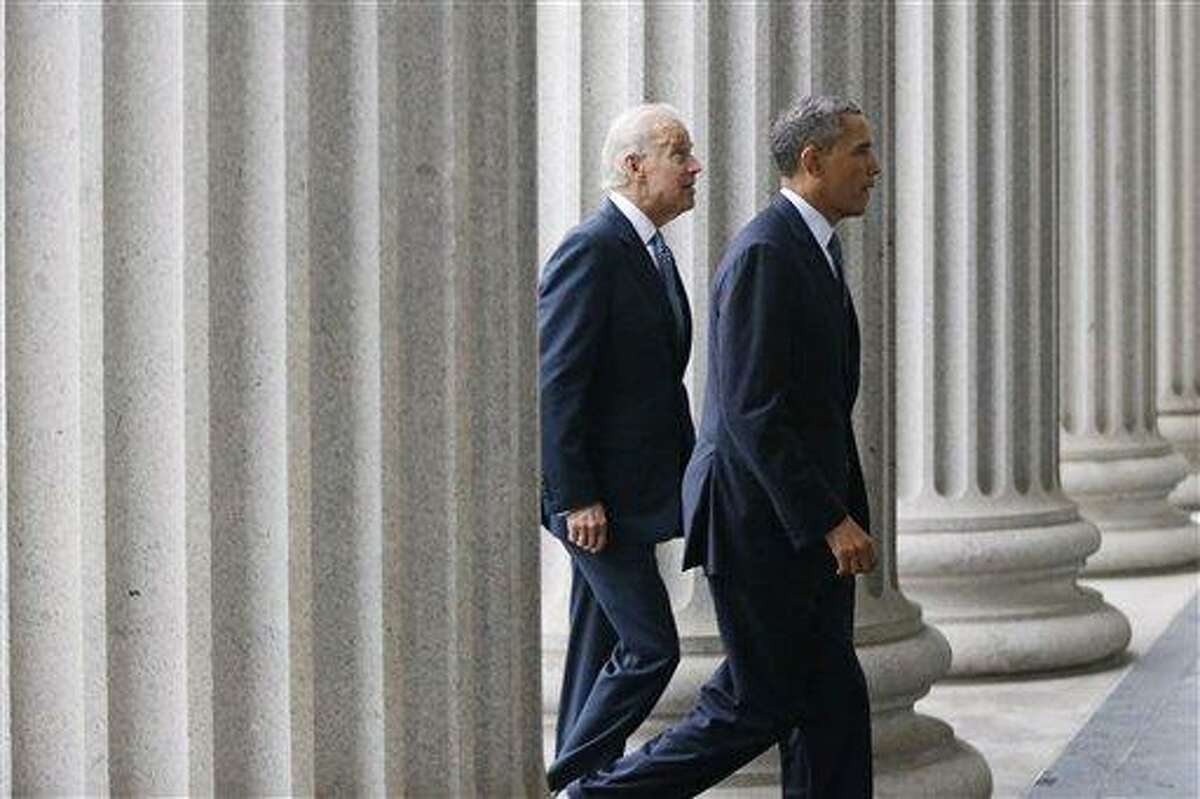 President Barack Obama, accompanied by Vice President Joe Biden, walks from the White House to the Treasury Department to attend an event for outgoing Treasury Secretary Timothy Geithner, Wednesday, Jan. 16, 2013. (AP Photo/Charles Dharapak)