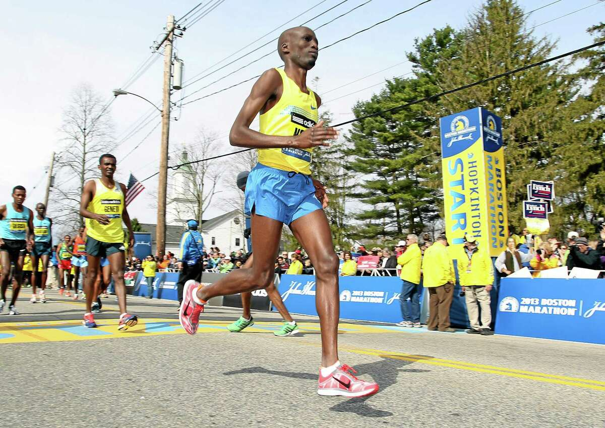 FILE - In this April 15, 2013, file photo, Wesley Korir, of Kenya, warms up prior to the start of the 117th running of the Boston Marathon, in Hopkinton, Mass. Korir had recently been elected to Parliament in his native Kenya. (AP Photo/Stew Milne, File)